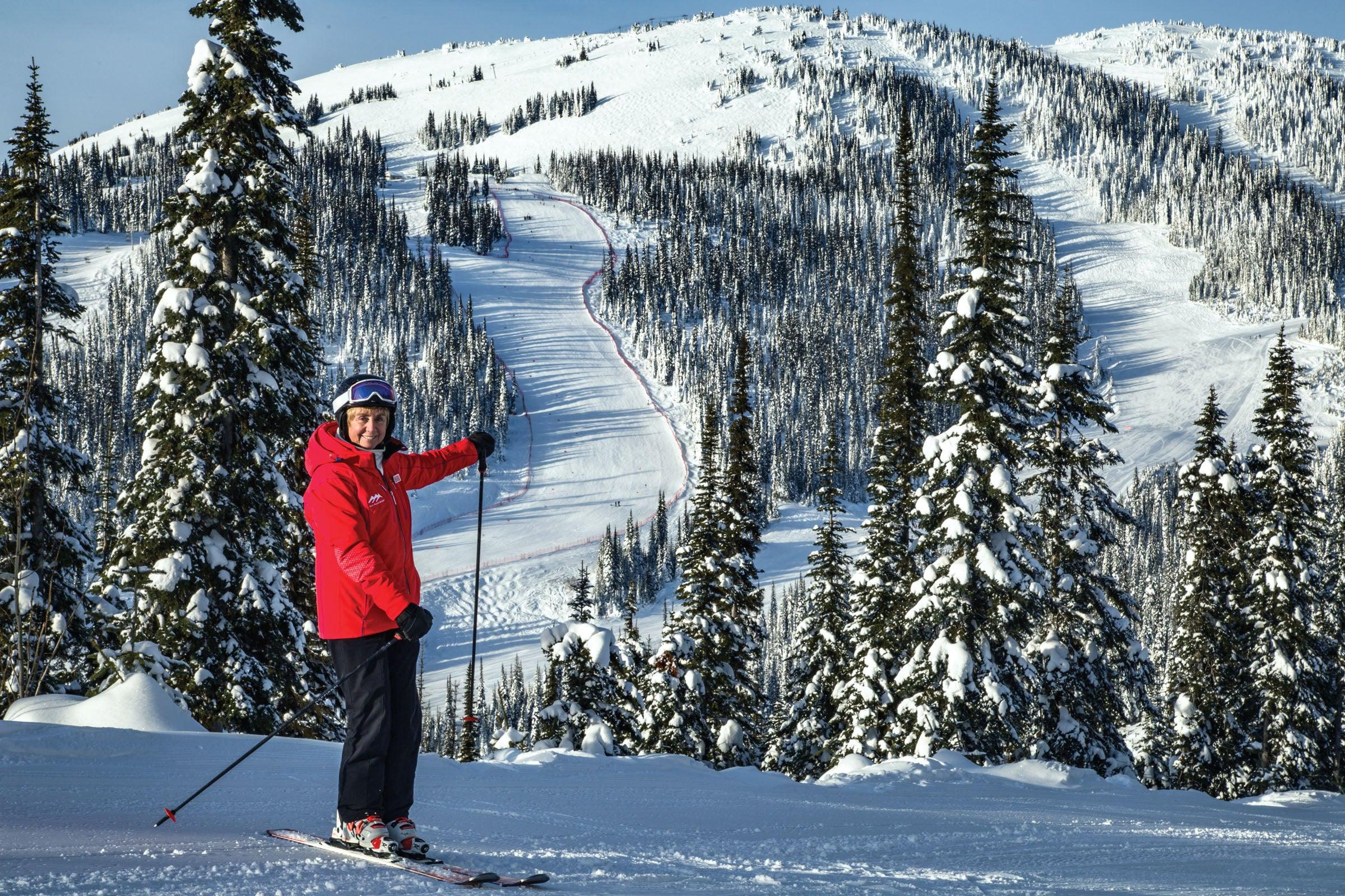 Nancy Greene poses in front of Sun Peak's OSV run