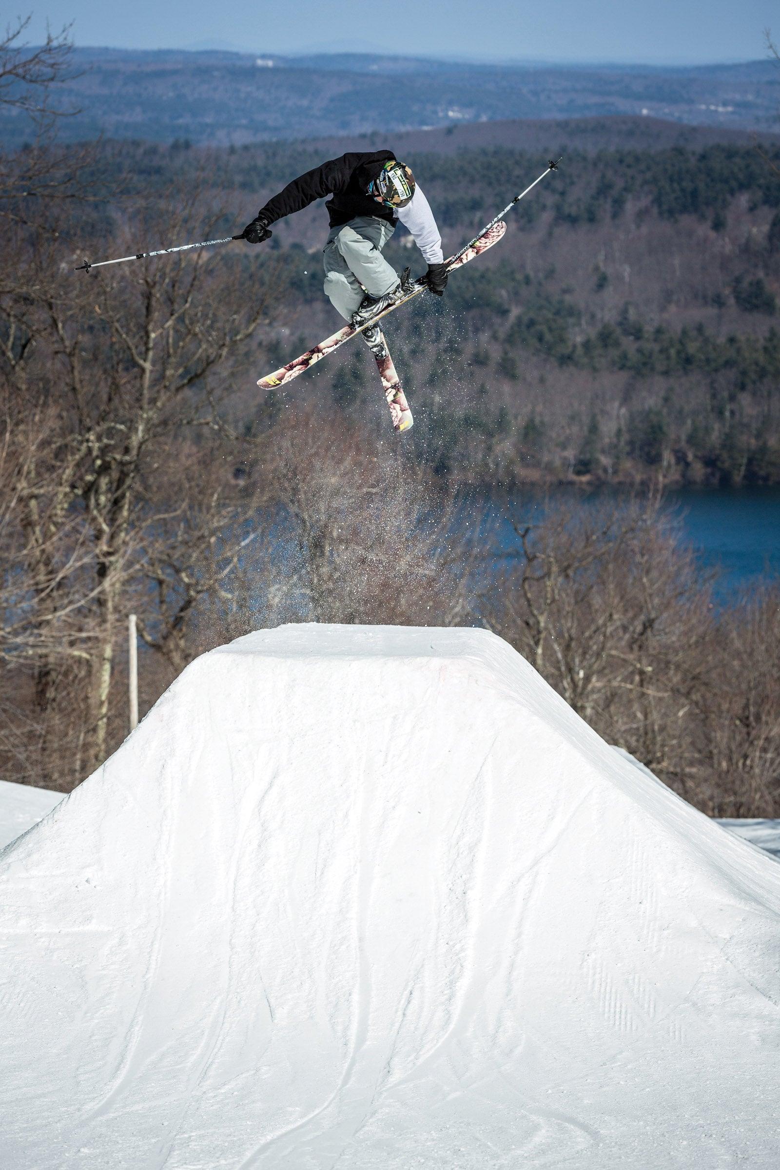 Skier in air with crossed skis