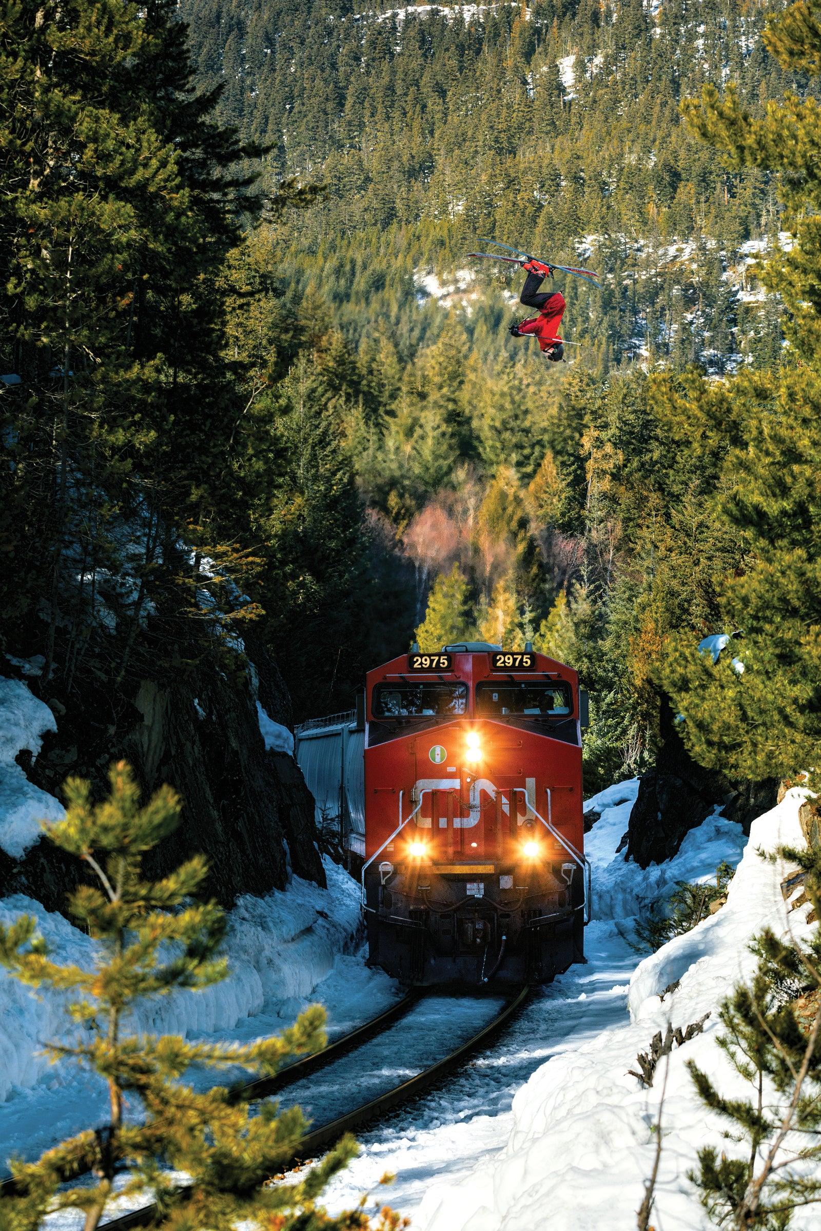 Eli Bucher backflips over a passing train
