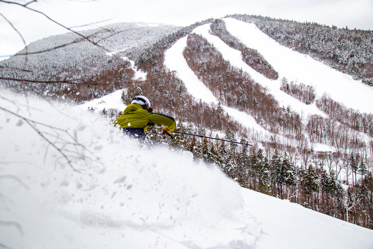Skier skis powder at Waterville Valley Resort
