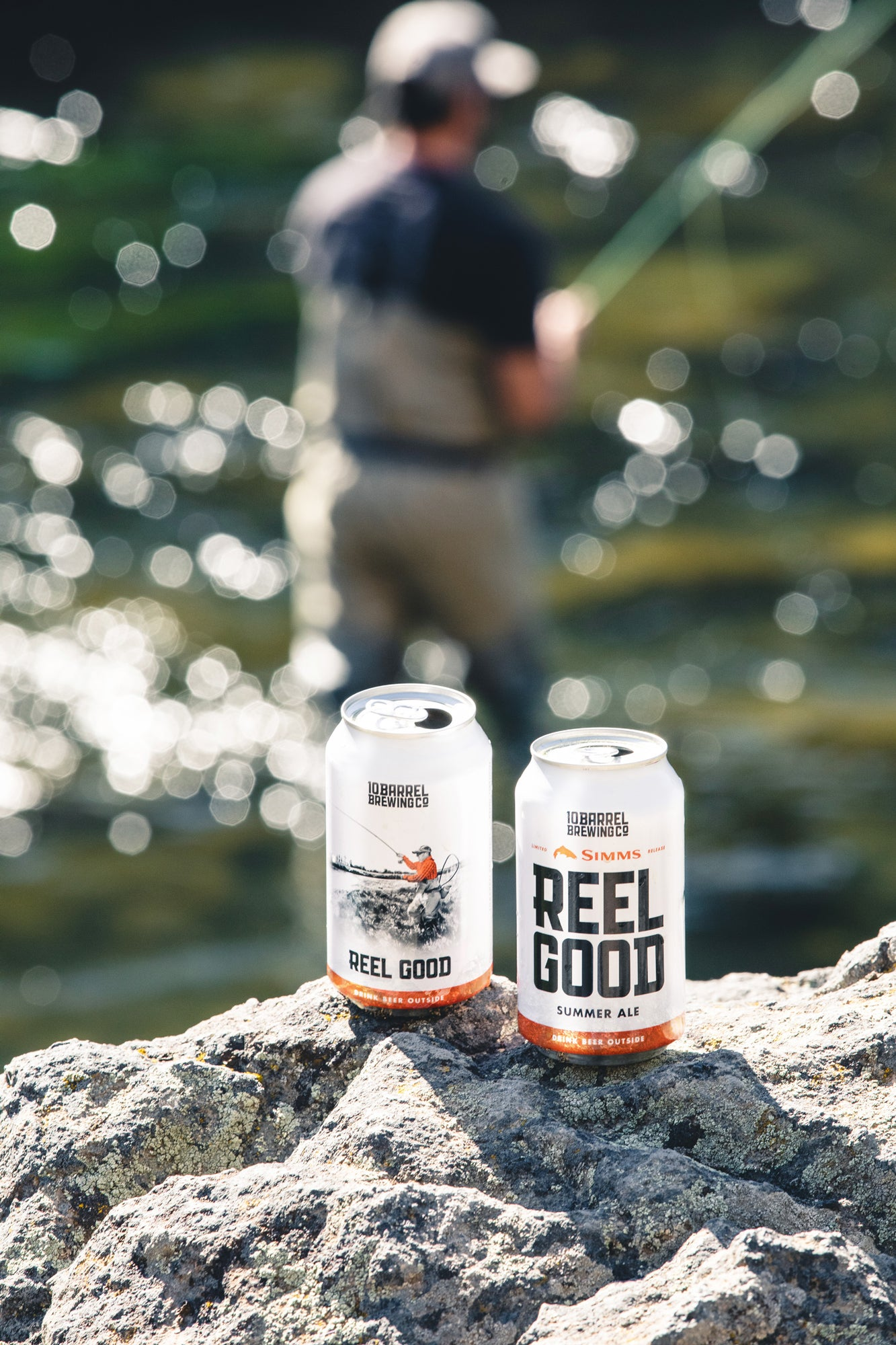 Two cans of Reel Good Summer Ale and a fisherman